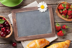 Blackboard, croissants and coffee Royalty Free Stock Photo