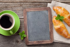 Blackboard, croissants and coffee Royalty Free Stock Images