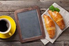 Blackboard, croissants and coffee Stock Photo