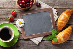 Blackboard, croissants and coffee cup Royalty Free Stock Photography