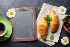 Blackboard, croissants and coffee cup Stock Images