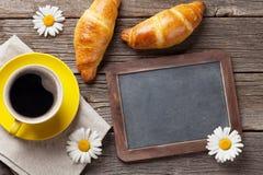 Blackboard, croissants and coffee Stock Photos