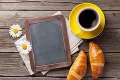 Blackboard, croissants and coffee Stock Image