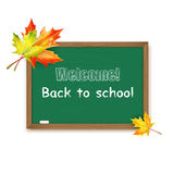 Blackboard decorated with autumn maple leaves Royalty Free Stock Photo