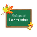 Blackboard decorated with autumn maple leaves Royalty Free Stock Photos