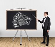 Blackboard with dollars Royalty Free Stock Photos
