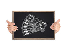 Blackboard with dollars Royalty Free Stock Images