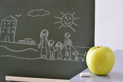 Blackboard with a drawing of a child and an apple Stock Photo