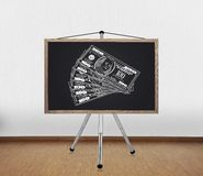 Blackboard with drawing dollars Stock Photo