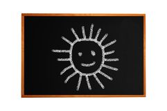 Blackboard with drawing smiling sun isolated Royalty Free Stock Image