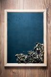 Blackboard and dried basil Stock Photo