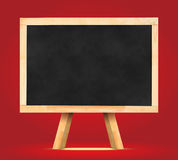 Blackboard with easel in studio room,Template for your content. Stock Photos