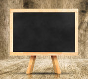 Blackboard with easel in studio room,Template for your content. Royalty Free Stock Images