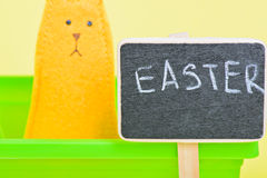 Blackboard with easter bunny on the background Stock Images
