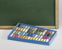 Blackboard edge and crayons Royalty Free Stock Photography