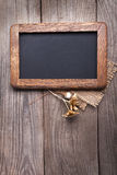 Blackboard empty decorated with dried flowers on the old wooden stock photography