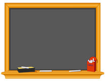 Blackboard, Eraser and Box of Chalk. Copy space to add your own text, notes or drawings to this old fashioned wood and slate blackboard with eraser and red box Stock Photography