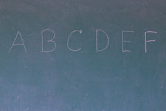 Blackboard with the first letters of the alphabet written on it Stock Image