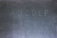 Blackboard with the first letters of the alphabet Stock Images
