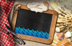 Blackboard for Fish Menu in a Beach Stock Photo