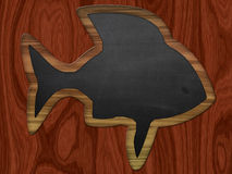 Blackboard fish on wood background Stock Photo