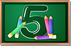 A blackboard with five pencils Royalty Free Stock Photo