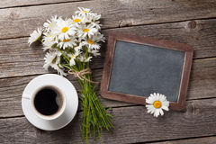 Blackboard, flowers and coffee cup Royalty Free Stock Photography