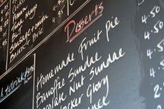 Blackboard food menu. Photo of a blackboard chalk menu showing food and prices Stock Images