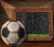 Blackboard with Football Field and Ball Stock Photo