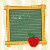 Blackboard Frame, ABCs, Apple for the Teacher. Back to School blackboard with wooden ruler frame, ABCs, and an apple for the teacher. Add your own text or art stock illustration