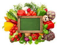 Blackboard with fresh organic vegetables and herbs Stock Photography