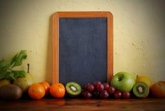 Blackboard and fruit Stock Photo