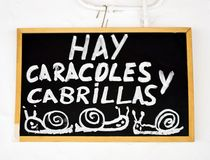 Bar of Seville specialized in snails, Spain. Blackboard with the gastronomic specialties of the bar placed on the facade, Andalusia, Spain Royalty Free Stock Photography