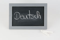 Blackboard German with chalk Royalty Free Stock Photography