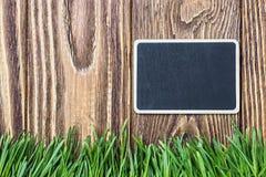 Blackboard and green grass Stock Photo