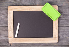 Blackboard green sponge and white chalk Royalty Free Stock Photography
