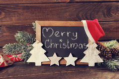 Blackboard with greetings written by chalk and christmas decorat Royalty Free Stock Photo