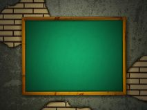 Blackboard at grunge wall Royalty Free Stock Images
