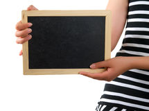 Blackboard in hand Royalty Free Stock Image