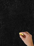 Blackboard. The hand writing with chalk.  Vertical shot Stock Images