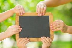 Blackboard in hands stock photos