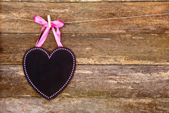 Blackboard heart with pink border and ribbon on clothespin again Stock Photo