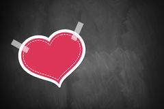 Blackboard with heart Stock Images