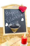 Blackboard with hearts and and a wine glass Stock Photography