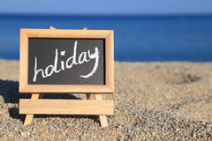 Blackboard with holiday text Stock Image