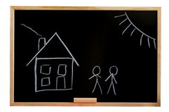Blackboard with house drawing Royalty Free Stock Images