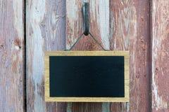 Blackboard i stare deski Zdjęcie Royalty Free