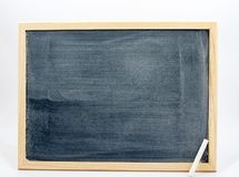 Blackboard isolated on a white background with a white chalk in the corner Stock Photo