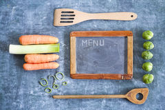 Blackboard, kitchen utensils, foods Royalty Free Stock Photos
