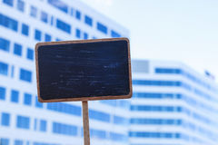 Blackboard label and a city landmark in the background Royalty Free Stock Photo